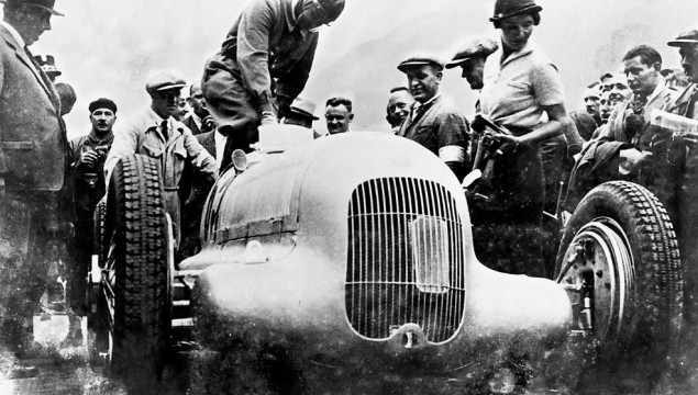 Caracciola loading himself into a Mercedes-Benz W25 Silver Arrow at the International Klausen Pass Race in Switzerland in 1934- He would go on to win