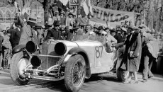 Rudolf Caracciola and Wilhelm Sebastian at the start of Mille Miglia 1931 in Brescia. As the starter counts down the final seconds before the start, Caracciola's wife is just saying goodbye to her husband, and co-driver Sebastian waves goodbye. All of the headlamps have caps to protect them from flying stones – indispensible given the many dirt roads in the race.