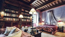 Painted in medieval manuscript colours of pink and lilac. Guests enter into a large bedroom, complete with sitting area in front of a hand-carved stone fireplace between two archways which lead into the en-suite bathroom. Both rooms are lined with 16th century carved walnut bookshelves, filled with historical and classic books for you to read. From the small walk-on balcony in the bathroom there is a wonderful view of the hills, which can also be viewed while taking a soak in the large bathtub.