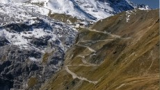 Stelvio Pass in the Italian Alps is the highest paved mountain pass in the Eastern Alps at 9,045 ft. Well known in the cycling and motorcycling world, the Stelvio Pass in Italy is also a dream drive for auto enthusiasts with its 60 hairpin turns (48 on the Northern side), steep inclines and narrow roads.