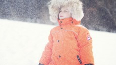 Canada Goose Grizzly Snowsuit Orange in snow