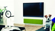 Libratone Lounge lime green on wall under television