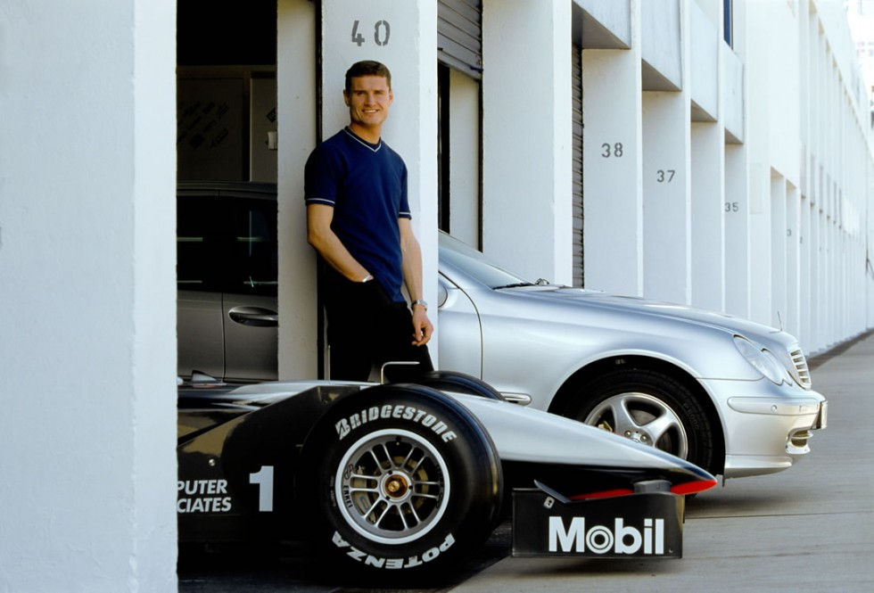 David Coulthard, former Formula One racing driver on McLaren-Mercedes, with McLaren-Mercedes MP4-15 and Mercedes-Benz C 320 (203 series). Photo from 2000.