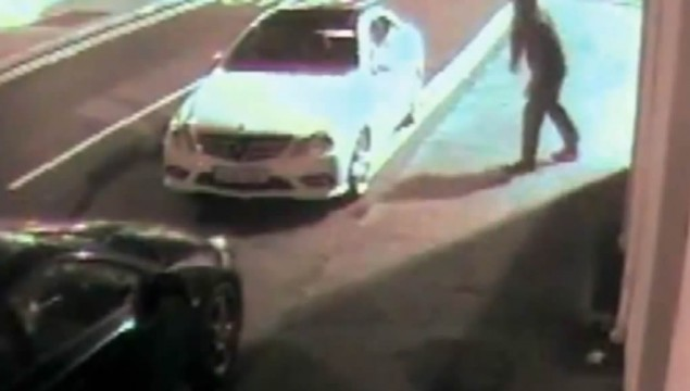 Thief throws brick at car