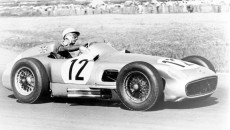 Stirling Moss, later to emerge as the winner of the race, in the British Grand Prix, 1955.