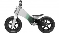 "Balance bike MOTORSPORT made from wood. Silver-coloured with Petronas green/black Mercedes-Benz Motorsport look,12-inch wheels with black plastic rims, 3D star logo on front and white ""Mercedes-Benz Motorsport"" print on side. Adjustable seat height (approx. 32−36 cm). Age 3+. Item number B67995141. Price: 129.90 €"