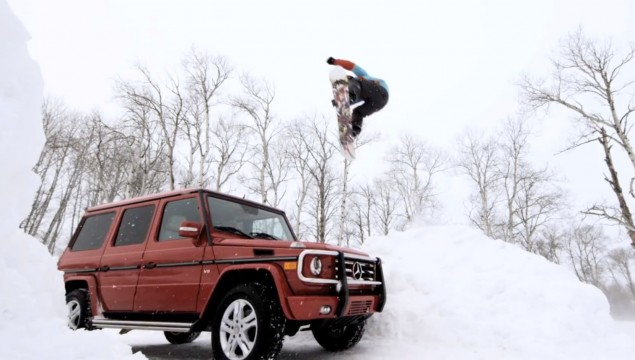 A Mercedes-Benz C350 4MATIC pulls pro-snowboarder, Rob Kingwill, down a fresh powder covered street in Jackson, WY