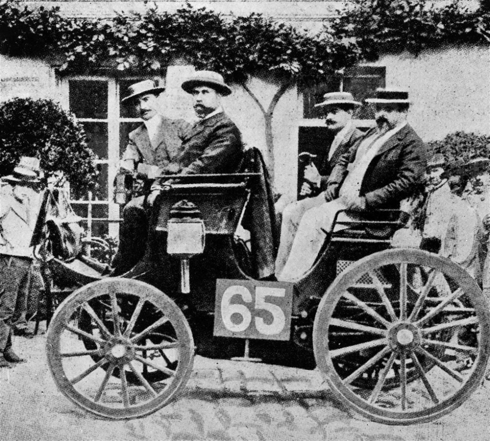 The first car race from Paris to Rouen, 22 July 1894. The Peugeot from Albert Lemaître (starting number 65), pictured on the left-hand rear seat Adolphe Clément. The Peugeot with an engine manufactured under licence from Daimler was the first vehicle with a combustion engine to finish the race, crossing the line in second.