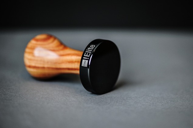 Torr Tamper Rosewood Handle and Black Titanium Piston laying down piston view